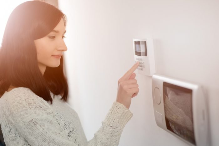 Woman updating her home security system